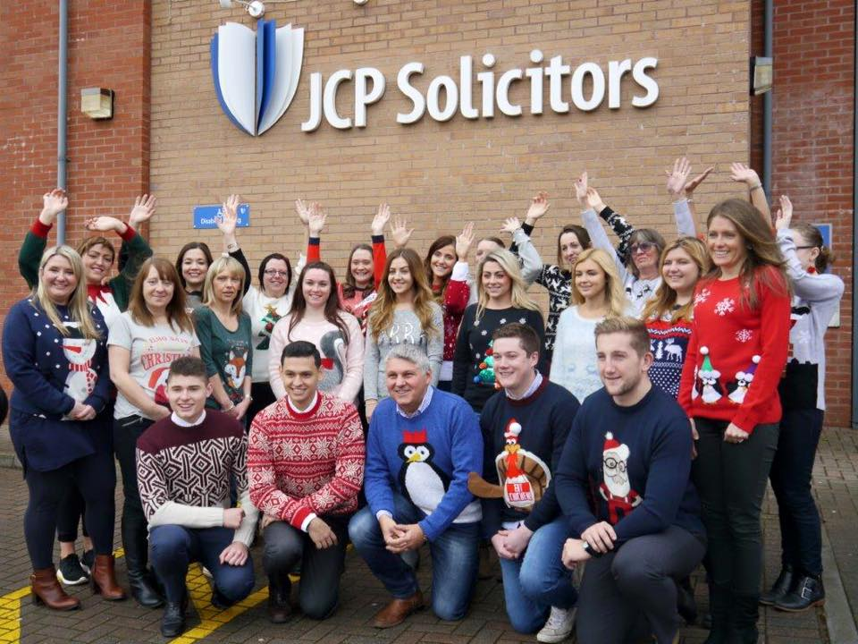 JCP Solicitors staff wearing Christmas jumpers