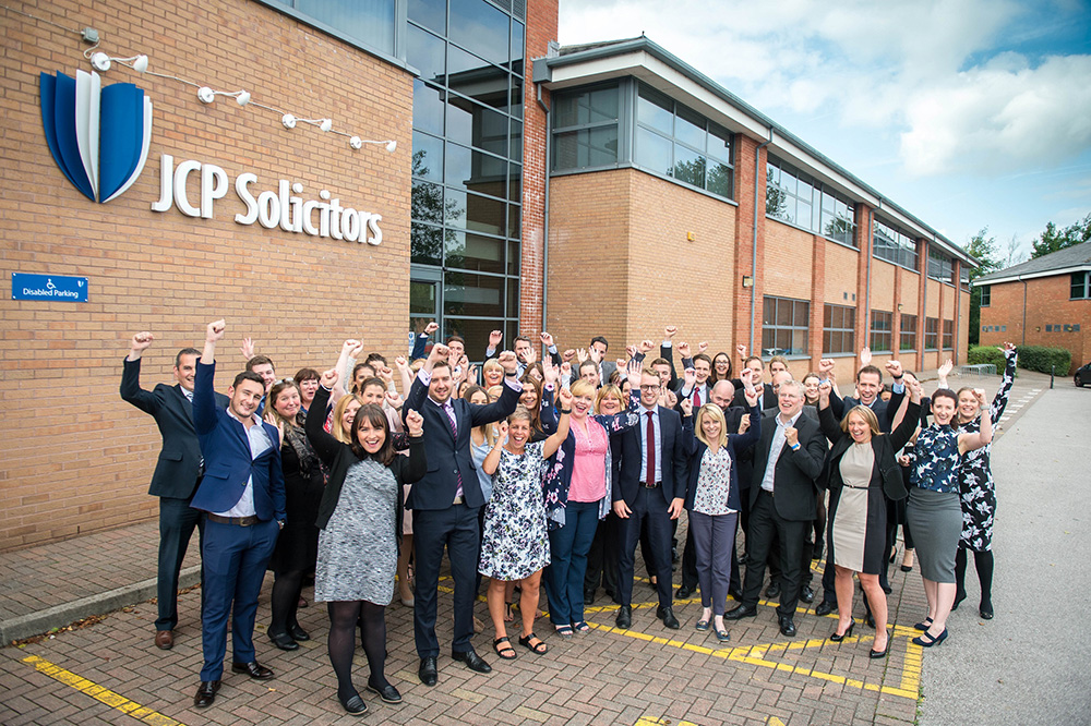 JCP Solicitors staff outside office