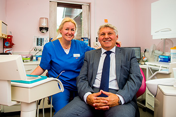 Dentist, Raminta Urbonaviciene, with Chris Davies