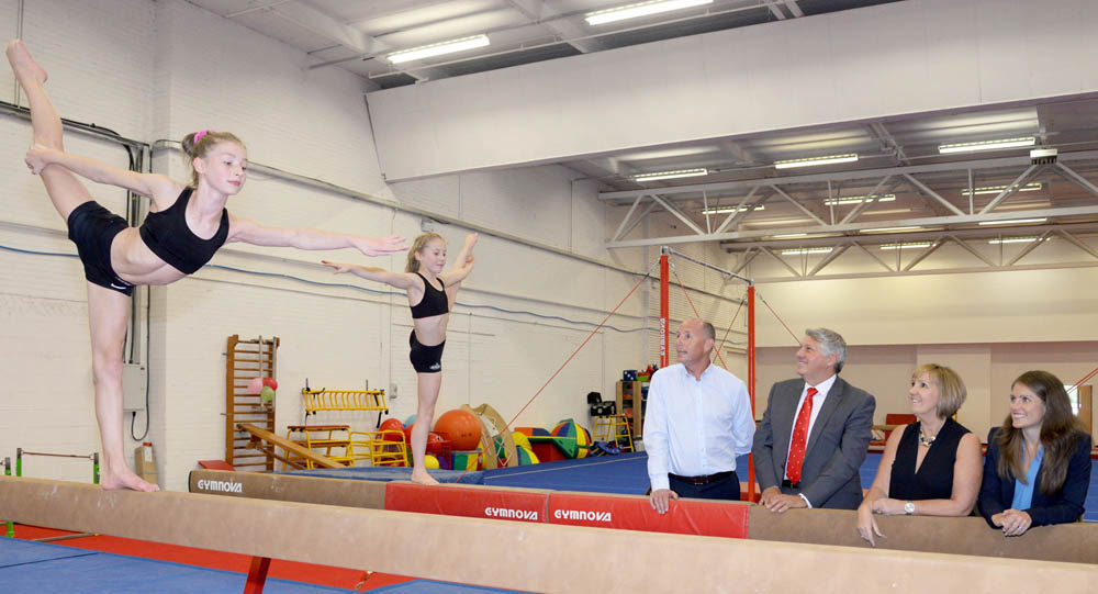 Gymnasts on balancing beams