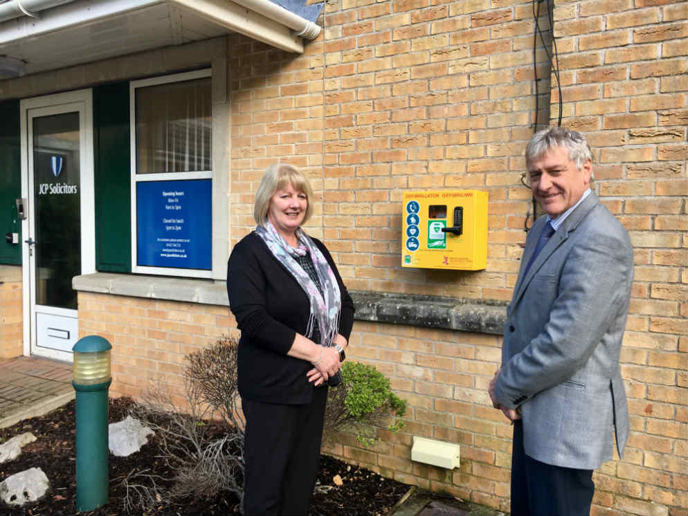 Carole Jenkins and Ian Fudge with defibrillator